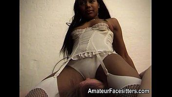 Ebony woman in white underware controls a chap