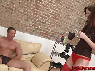 Fem slaver restrains muscle sub for anal toying