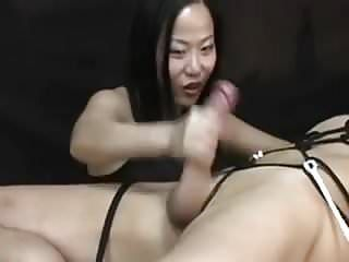 Oriental woman torturing him post agonorgasmos tugjob