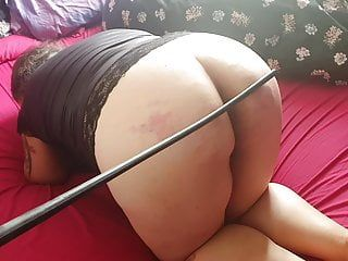 Obedient bbw floozy caned in advance of having the one and the other holes plugged.