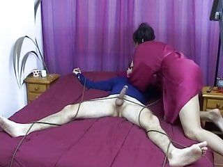 Goddess abuses homosexual serf by milking him