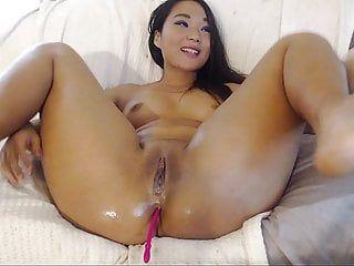 Oriental honey using fake penis