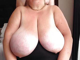 Giant tits bound taut and caressed