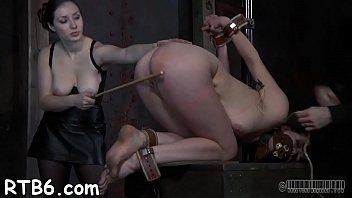 Upside down babe receives her teats clipped during hardore sex