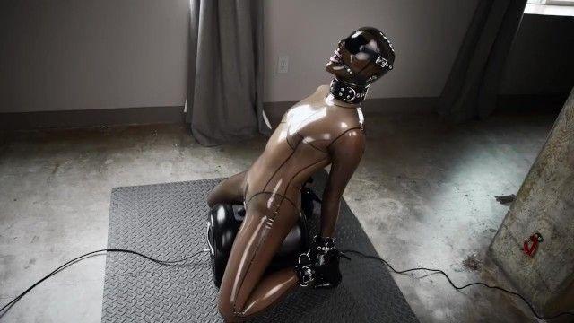 Bound in latex sex saddle