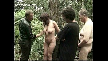 Milf bondman bound to a tree acquires spanked on her legs and hit on her fur pie by dominant