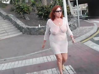 Marvelous aged floozy walks around the town with stripped melons