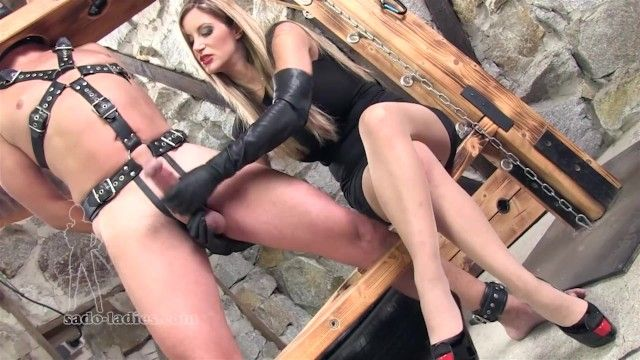 Mistresss wearing elbow leather gloves give a tugjob to the thraldom villein