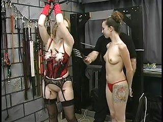 Thick large booty sadomasochism lesbo is tortured by her taskmaster and domme in dungeon