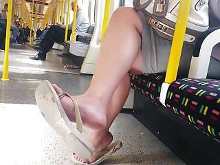 Candid admirable feet in flip flops on tube faceshot